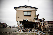 This house, about 500m away from the ocean, barely stands on the ground but the first floor has been completely ruined by the tsunami in Ishinomaki city.