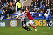 Atdhe Nuhiu of Sheffield Wednesday competes for the ball with Tomas Kalas of Bristol City FC during the EFL Sky Bet Championship match between Sheffield Wednesday and Bristol City at Hillsborough, Sheffield, England on 22 December 2019.