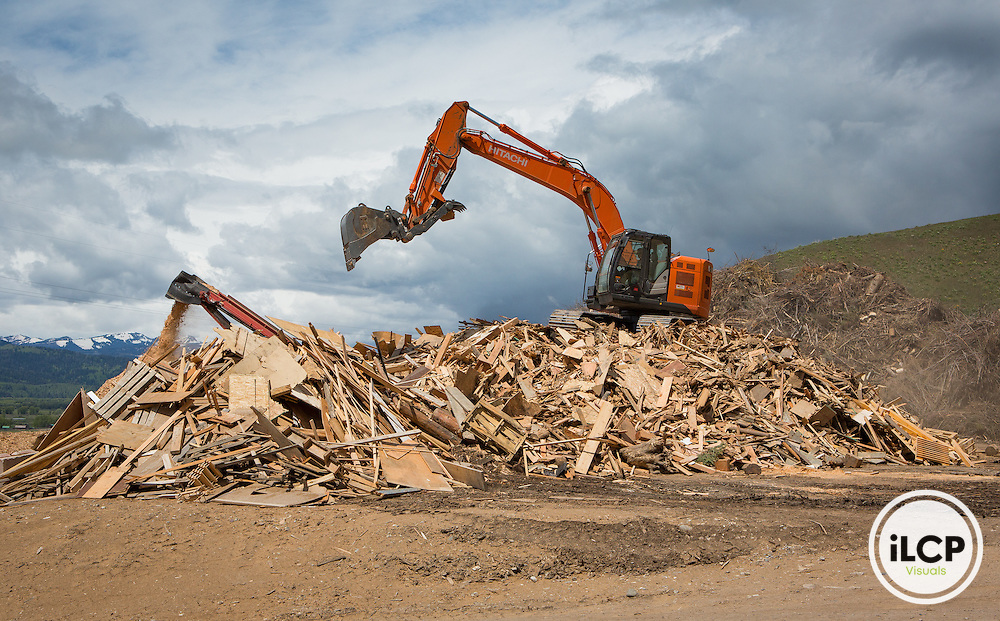 Wood waste is prepared for processing at the Teton County Waste and Recycling facility.