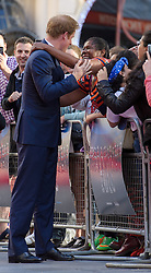 Image ©Licensed to i-Images Picture Agency. 10/06/2014. London, United Kingdom. HRH Prince Harry attends the 50th Anniversary of Zulu premiere. . Picture by Anthony Upton / i-Images<br /> Leicester Square, London, 10 June 2014: HRH Pr. Harry is embraced by a member of the public on the red carpet at a gala screening to celebrate the 50th Anniversary of Zulu where guests were joined by Prince Harry to watch a digitally remastered version of the iconic film. The evening was arranged to raise money for two charities supported by Prince Harry, Walking With The Wounded and Sentebale. <br /> For further info please contact<br /> Emily Conrad-Pickle Captive Minds<br /> Mobile: +44 (0)7799 414 790<br /> emily.conrad-pickles@captiveminds.com