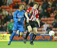 Photo. Andrew Unwin<br /> Sunderland v Cardiff City, Nationwide League Division One, Stadium of Light, Sunderland 14/10/2003.<br /> Sunderland's Jeff Whitley (r) holds off Cardiff's Daniel Gabbidon (l).