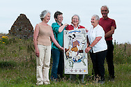 Crewel Chicks Stitching group portrait for the Great Tapestry of Scotland project. Photographed with the panel of James Hutton at Siccar Point in Berwickshire, Scotland<br /> www.scotlandstapestry.com<br /> <br /> pictures by Alex Hewitt