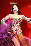 The famous pin-up star, and wife of Marilyn Manson, Dita Von Teese is posing on stage at the Erotica 2006 show in London, UK, on Friday, Nov. 17, 2006. Erotica is the world's largest adult lifestyle show. It attracts about 80,000 visitors every year with its over 150 retailer exhibitors, dazzling and decadent transvestite cabaret shows, fun foreplay seminars, beautiful lingerie collections, art and fetish demonstrations. **Italy Out**