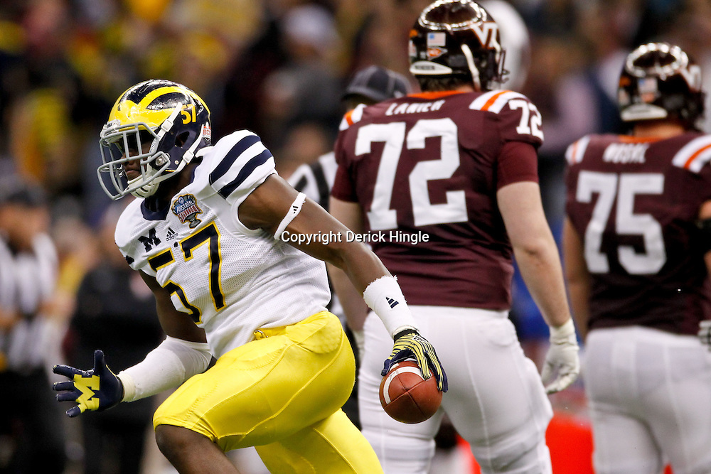 January 3, 2012; New Orleans, LA, USA;Michigan Wolverines defensive end Frank Clark (57) celebrates following a turnover against the Virginia Tech Hokies during the third quarter of the Sugar Bowl at the Mercedes-Benz Superdome.  Mandatory Credit: Derick E. Hingle-US PRESSWIRE