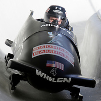 01 March 2009:   The USA 1 bobsled driven by Steven Holcomb with sidepushers Justin Olsen and Steve Mesler, and brakeman Curtis Tomasevicz drives through turn 19 in the 3rd run at the 4-Man World Championships competition on March 1 at the Olympic Sports Complex in Lake Placid, NY.   The USA 1 bobsled won the competition and the World Championship bringing the U.S. their first world championship since 1959 with a time of 3:36.61.