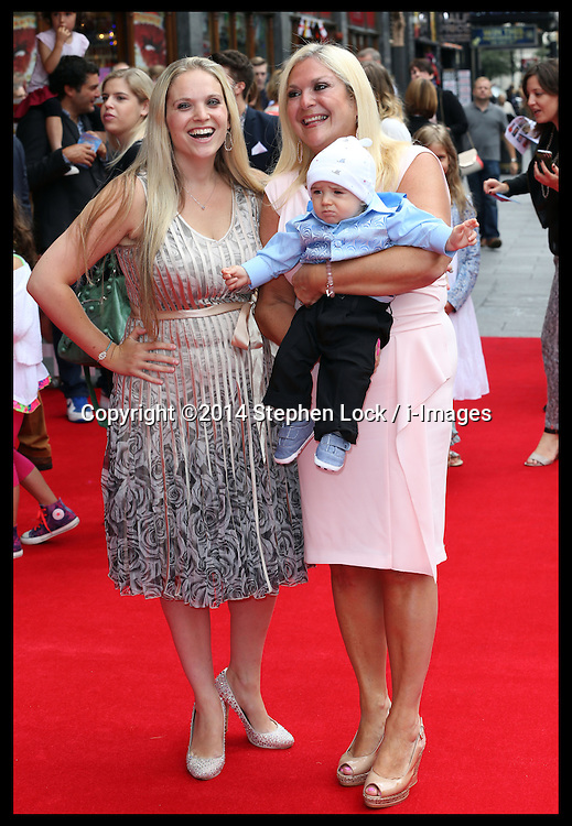 Image licensed to i-Images Picture Agency. 13/07/2014. London, United Kingdom. Vanessa Feltz with her daughter and grandson  at the World premiere of Pudsey The Dog : The Movie in London.  Picture by Stephen Lock / i-Images