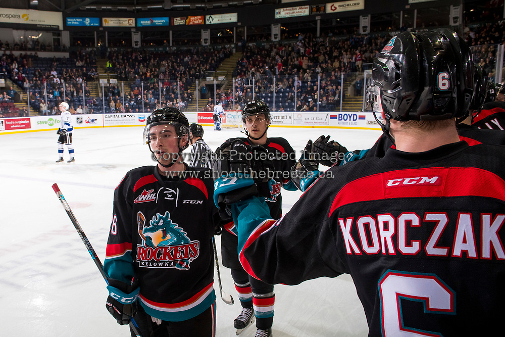 KELOWNA, CANADA - NOVEMBER 23: Liam Kindree #26 and Leif Mattson #28 of the Kelowna Rockets skate by the bench for high-fives to celebrate a goal against the Victoria Royals  on November 23, 2018 at Prospera Place in Kelowna, British Columbia, Canada.  (Photo by Marissa Baecker/Shoot the Breeze)