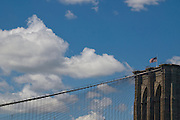 The top of the Brooklyn Bridge and its suspension cables as viewed from Brooklyn Bridge Park. At 5,989 feet (1825 m), it was the longest suspension bridge in the world from its 1883 to 1903.