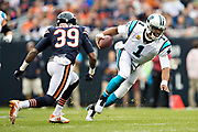 CHICAGO, IL - OCTOBER 22:  Cam Newton #1 of the Carolina Panthers dives for a first down to avoid the tackle of Eddie Jackson #39 of the Chicago Bears at Soldier Field on October 22, 2017 in Chicago, Illinois.  The Bears defeated the Panthers 17-3.  (Photo by Wesley Hitt/Getty Images) *** Local Caption *** Cam Newton; Eddie Jackson
