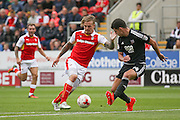 Rotherham United midfielder Danny Ward (9)  can't get past Brentford  defender John Egan (14)  during the EFL Sky Bet Championship match between Rotherham United and Brentford at the New York Stadium, Rotherham, England on 20 August 2016. Photo by Simon Davies.