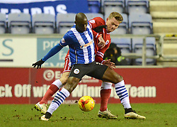 Cardiff City's Aron Gunnarsson tangles with Wigan Athletic's Marc-Antoine Fortune - Photo mandatory by-line: Richard Martin-Roberts/JMP - Mobile: 07966 386802 - 24/02/2015 - SPORT - Football - Wigan - DW Stadium - Wigan Athletic v Cardiff City - Sky Bet Championship