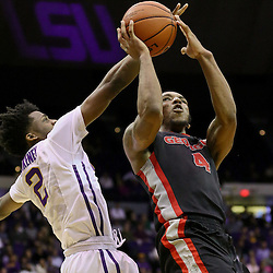 Jan 26, 2016; Baton Rouge, LA, USA; Georgia Bulldogs guard Charles Mann (4) shoots over LSU Tigers guard Antonio Blakeney (2) during the second half of a game at the Pete Maravich Assembly Center. LSU defeated Georgia 89-85. Mandatory Credit: Derick E. Hingle-USA TODAY Sports