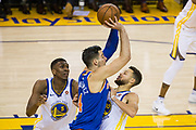 Golden State Warriors forward Kevon Looney (5) and Golden State Warriors guard Stephen Curry (30) double team the New York Knicks offense at Oracle Arena in Oakland, Calif., on May 2, 2017. (Stan Olszewski/Special to S.F. Examiner)