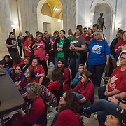 Teachers and school personnel watch a conference  committee hearing in session at the capitol in Charleston, W.V., on Monday, March 05, 2018; the eighth day of statewide school closures. The hearing was called as a discussion to end the impasse between the House and Senate regarding pay increases for education personnel.