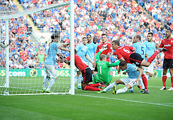 Cardiff City's Fraizer Campbell scores to make it 2-1  - Photo mandatory by-line: Joe Meredith/JMP - Tel: Mobile: 07966 386802 25/08/2013 - SPORT - FOOTBALL - Cardiff City Stadium - Cardiff -  Cardiff City V Manchester City - Barclays Premier League