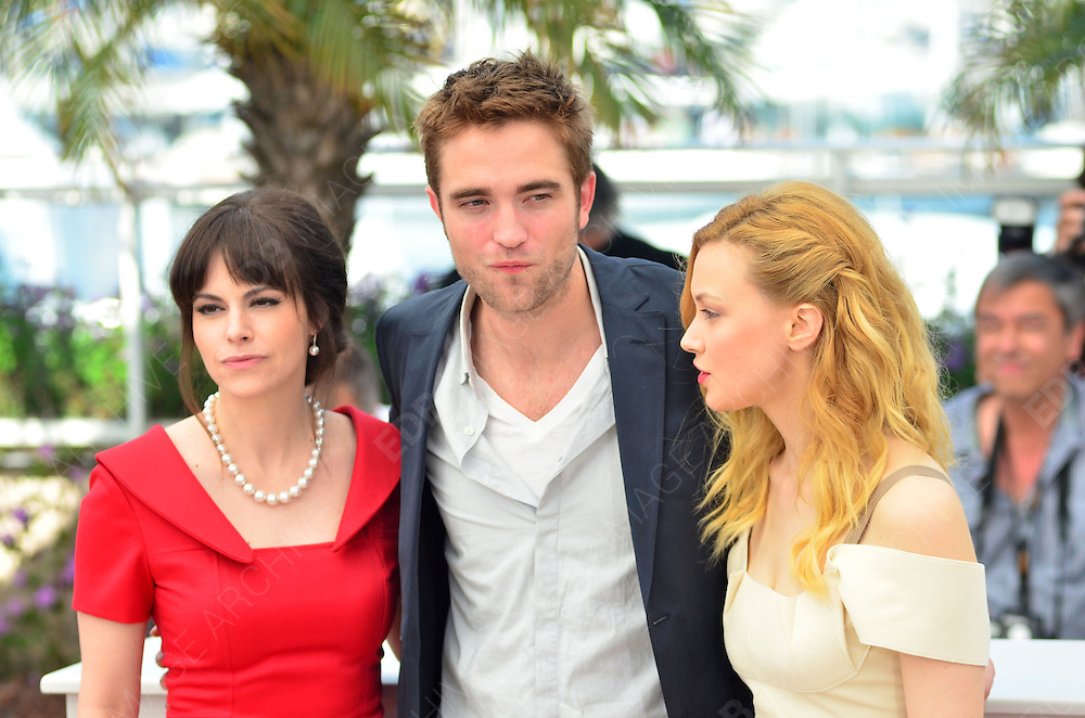 25.MAY.2012. CANNES<br /> <br /> EMILY HAMPSHIRE, ROBERT PATTINSON AND SARAH GADON AT THE COSMOPOLIS PHOTOCALL DURING THE 65TH CANNES FILM FESTIVAL, CANNES, FRANCE.<br /> <br /> BYLINE: JOE ALVAREZ/EDBIMAGEARCHIVE.CO.UK<br /> <br /> *THIS IMAGE IS STRICTLY FOR UK NEWSPAPERS AND MAGAZINES ONLY*<br /> *FOR WORLD WIDE SALES AND WEB USE PLEASE CONTACT EDBIMAGEARCHIVE - 0208 954 5968*