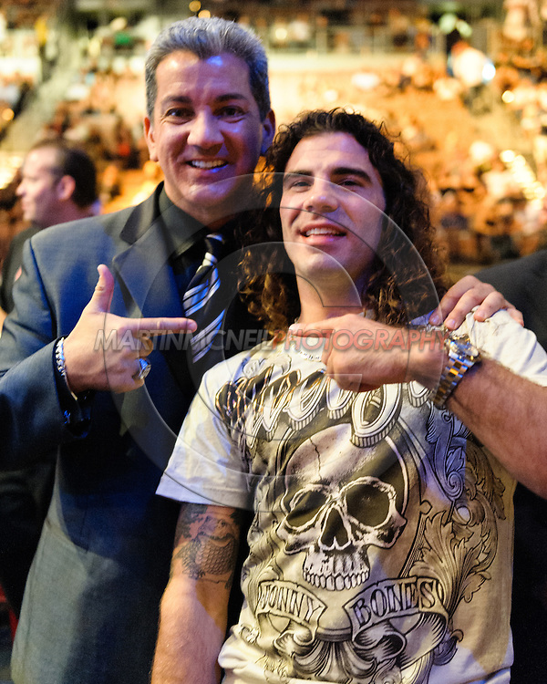 """LAS VEGAS, NEVADA. JULY 11, 2009: Announcer Bruce Buffer (left) poses with fighter Clay Guida during """"UFC 100: Making History"""" inside the Mandalay Bay Events Center in Las Vegas, Nevada."""