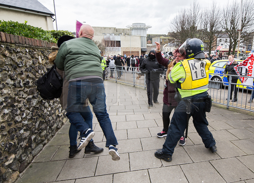 © Licensed to London News Pictures . 30/01/2016 . Dover , UK . Police separate fighting protesters . Demonstrations by far-right groups (including The National Front , The North West Infidels and The South East Alliance ) and , opposing them , anti-fascists , close to the port of Dover in Kent . Photo credit : Joel Goodman/LNP