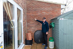 Homeowner Larry Lott points out the incursion of a neighbour's extension, for wing planning consent was not required, onto his property in Hampton, West London. London, February 28 2019.