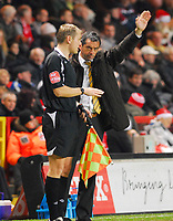 Photo: Leigh Quinnell/Sportsbeat Images.<br /> Charlton Athletic v Hull City. Coca Cola Championship. 22/12/2007. Hull manager Phil Brown waves to the crowd and chats to the linesman.