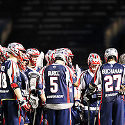 Members of the Boston Cannons huddle during the game at Harvard Stadium on May 10, 2014 in Boston, Massachusetts. (Photo by Elan Kawesch)