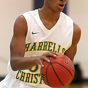 Harrells Christian's Quate McKinzie drives against West Brunswick on the first day of the Cape Fear Academy Holiday Basketball Tournament. (Jason A. Frizzelle)