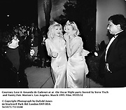Courtney Love & Amanda de Cadenet at at  the Oscar Night party hosted by Steve Tisch and Vanity Fair. Morton's. Los Angeles. March 1995. Film. 95555/32<br />© Copyright Photograph by Dafydd Jones<br />66 Stockwell Park Rd. London SW9 0DA<br />Tel 0171 733 0108