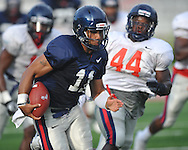 Mississippi quarterback Barry Brunetti runs upfield during a scrimmage at Vaught-Hemingway Stadium in Oxford, Miss. on Saturday, August 13, 2011. (AP Photo/Oxford Eagle, Bruce Newman)