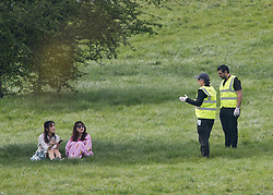 © Licensed to London News Pictures. 11/04/2020. London, UK. Camden Council workers ask people to move from  Primrose Hill, London due too a lack of police presence, during a pandemic outbreak of the Coronavirus COVID-19 disease. The public have been told they can only leave their homes when absolutely essential, in an attempt to fight the spread of coronavirus COVID-19 disease. Photo credit: Ben Cawthra/LNP