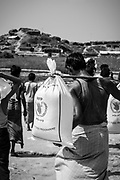 Rohingyas carrying food aid in Jamtoli refugee camp, Bangladesh (October 26, 2017)