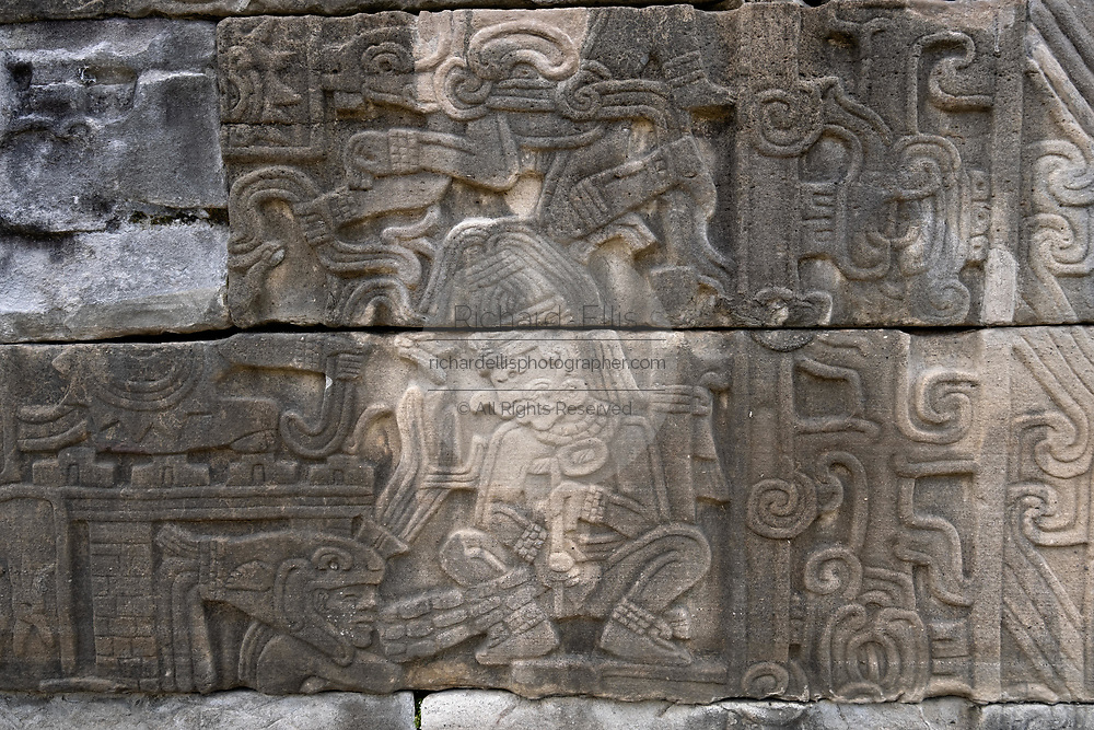 Carved relief panels on the walls of the South Ballcourt at the pre-Columbian archeological complex of El Tajin in Tajin, Veracruz, Mexico. El Tajín flourished from 600 to 1200 CE and during this time numerous temples, palaces, ballcourts, and pyramids were built by the Totonac people and is one of the largest and most important cities of the Classic era of Mesoamerica.