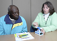 Tobacco Cessation Specialist Alison Diver (right) explains to Austin Jones, from Dayton how the carbon monoxide detector works at a smoking cessation counseling session at Samaritan North Health Center, Thursday, November 1, 2007.