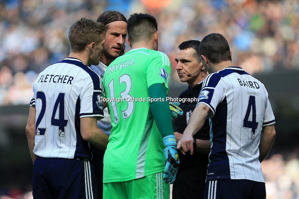 21st March 2015 - Barclays Premier League - Manchester City v West Bromwich Albion - West Brom players Darren Fletcher (L), Jonas Olsson (2L), goalkeeper Boaz Myhill and Chris Baird surround referee Neil Swarbrick after he brandished an early red card - Photo: Simon Stacpoole / Offside.