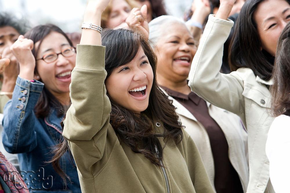 Crowd of women celebrating