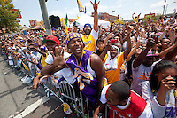 21 June 2010: Fans celebrate while watching the Lakers Championship Victory Parade on Figueroa BL. in Los Angeles, CA after the Lakers won the 2010 NBA Championship over the Boston Celtics in Game 7 of the NBA Finals.