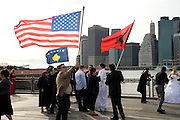 Kosovars with the new Kosovo and also the Albanian and the USA flag with Manhattan in the background