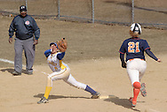 Middletown, NY - Gloucester County College first baseman Erin Clifford stretches to catch the ball as Kaitlyn Andryshak runs to the base during a women.s softball game on March 30, 2008.