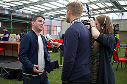 LIVERPOOL, ENGLAND - Wednesday, April 13, 2016: The Anfield Wrap's Andrew Heaton is interviews by Norwegian TV after Liverpool's press conference at Melwood Training Ground ahead of the UEFA Europa League Quarter-Final 2nd Leg match against Borussia Dortmund. (Pic by David Rawcliffe/Propaganda)