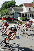 Riders lean into the final turn of the course at The 3rd Annual Uptown Pitman Bob Riccio Memorial Race.