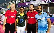 BHUBANESWAR (India) -  Hero Champions Trophy hockey men. Semifinal India vs Pakistan. Umpires Deon Nel and Eduardo Lizana with Sardar Singh of India and Muhammad Imran of Pakistan. Photo Koen Suyk