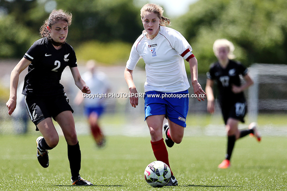 Emily Cooper of Auckland Football competes against Claudia Bunge of NZF Development . 2014 ASB Women's League football match, Auckland Football v NZF Development at William Green Domain, Auckland, New Zealand. Sunday 23 November 2014. Photo: Anthony Au-Yeung / photosport.co.nz