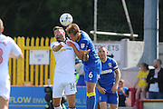 AFC Wimbledon defender Paul Robinson (6) and Bolton Wanderers striker Gary Madine (14) during the EFL Sky Bet League 1 match between AFC Wimbledon and Bolton Wanderers at the Cherry Red Records Stadium, Kingston, England on 13 August 2016. Photo by Stuart Butcher.