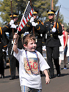 July 4, 2013:  Celebrants in the Palo Verde Neighborhood participate in the 50th annual Fourth of July parade to celebrate the anniversary of the independence of the United States in Tucson, Arizona, USA.  Wesley Webb, 4, (front), joins the Honor Guard from the Tucson Police Department at the head of the parade.