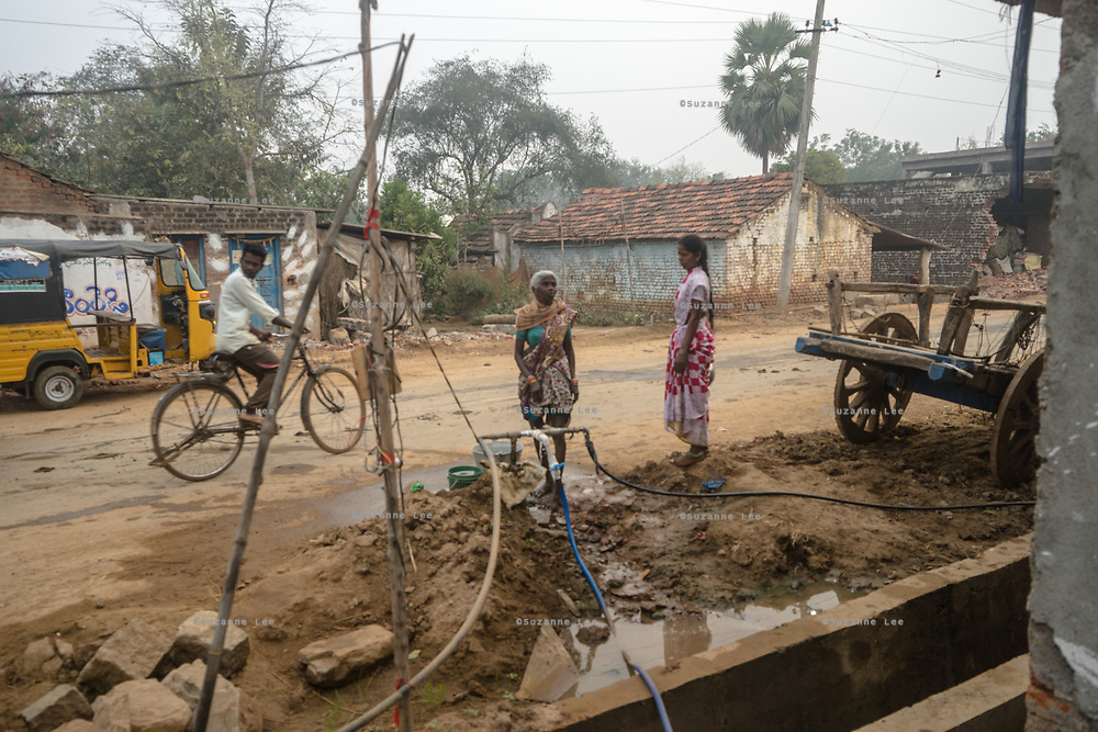 Local village women fetch water from a water tap in village Gorikothapally, Telangana, Indiia, on Friday, February 8, 2019. Photographer: Suzanne Lee for Safe Water Network