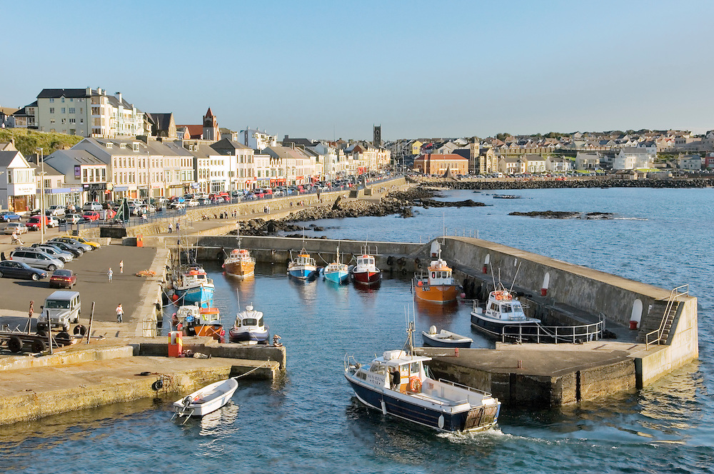 Portstewart fishing boat harbour and main street seafront, County Derry. 3 miles from Coleraine and Portrush, Northern Ireland.