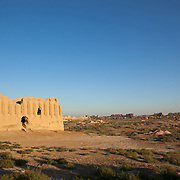 A building in the citadel of Gyaur Kala, an ancient city in Merv, Turkmenistan. Merv is the site of several ancient cities founded over the millennia, now a UNESCO World Heritage Site archaeology park in Turkmenistan.  It is the country's biggest tourist destination, as Merv was a major silk road city in its day, and according to some British archaeologists, it was the world's biggest city in the mid 12th century (and was at least the 3rd largest).  It was one of the Islamic world's greatest centres of learning, with 12 libraries and countless books.  It also appears to have been the furthest west point that Buddhism ever reached, with the discovery of a Buddha head statue in a complex within one of the older city walls -- quite possibly a meditation complex or monastery. The city may have been home to up to 1 million people when it was sacked by the Mongols.  The city surrendered, but the invaders killed all its inhabitants, and despite the attempt to revive it during Timur's empire, the city never flourished again.  Now a modern soviet town, Mary, is nearby.