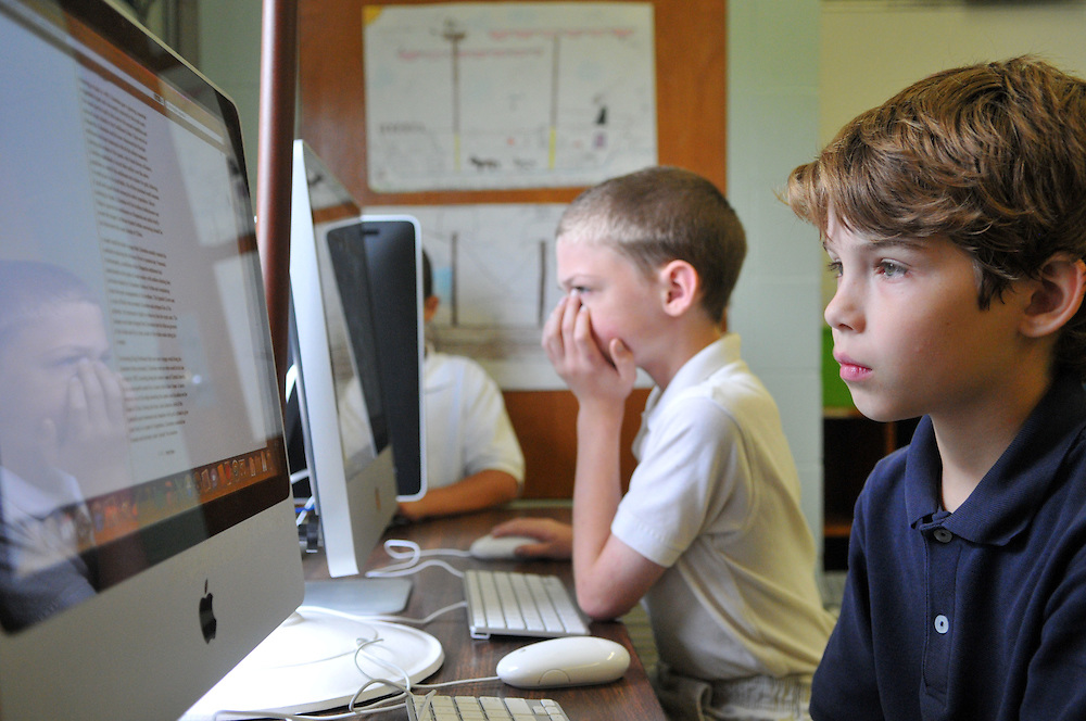 """Fourth graders Alex Hicks, center, and Jacob Gurt, right, work on researching a project about a world changing figure during a """"Reach"""" class for gifted students at Thames Elementary School Wednesday. Bryant Hawkins/ Hattiesburg American"""