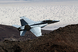 "US Navy Boeing F/A-18F Super Hornet XE-230 (USN 166925) from Air Test and Evaluation Squadron Nine (VX-9), from China Lake Naval Air Weapons Station, the ""Vampires"" flies through the Jedi Transition, R-2508 complex, Star Wars Canyon / Rainbow Canyon, Death Valley National Park, California, United States of America."