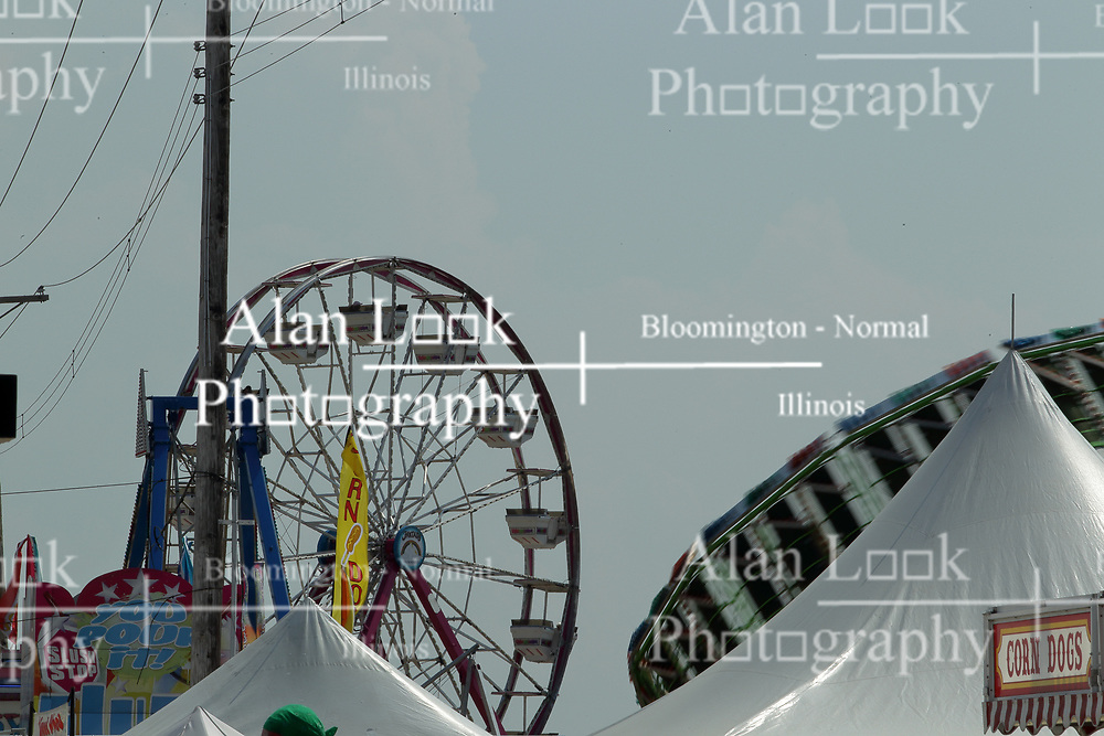 03 August 2017: Farris Wheel and round up rides behind midway tents at 2017 McLean County Fair<br /> <br /> #alphoto513