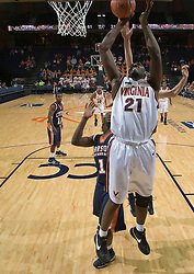 Virginia Cavaliers C Tunji Soroye (21)..The Virginia Cavaliers men's basketball team defeated the Carson-Newman Eagles 124-65 in an exhibition basketball game at the John Paul Jones Arena in Charlottesville, VA on November 4, 2007.